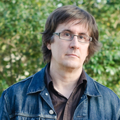 John Darnielle writes literary lyrics for the Mountain Goats, often telling stories about fictional characters or stories from his life. His new book, Wolf in White Van, is about a man who survives a trauma.