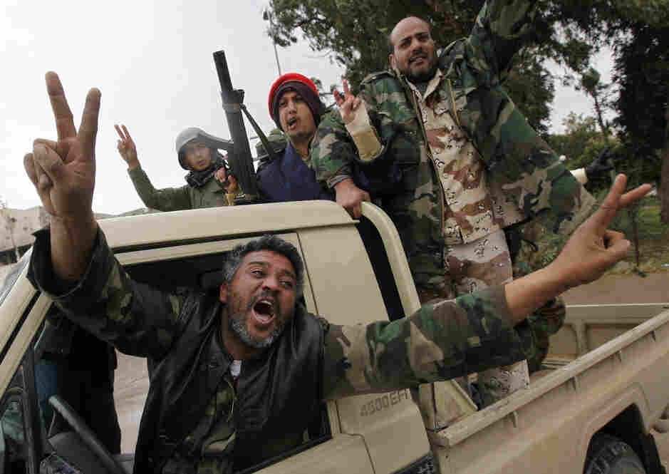 Libyan rebels celebrate in the eastern city of Benghazi on Feb. 27, 2011. U.S. airstrikes later that year helped the rebels overthrow Gadhafi, but the country has since descended into chaos.