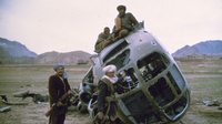 Afghan rebels, or mujahedeen, climb on a Soviet helicopter they shot down in 1981. U.S. assistance helped the rebels drive out the Soviet forces. But the chaotic conditions in Afghanistan allowed al-Qaida to take root in the 1990s.