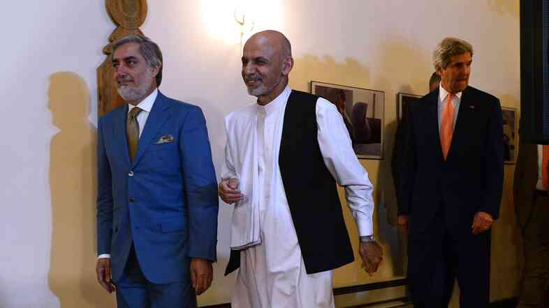 Abdullah Abullah (left) and Ashraf Ghani, shown here on August 8, have been contesting the results of Afghanistan's runoff presidential election for months. They are expected to sign a power-sharing deal on Sunday.