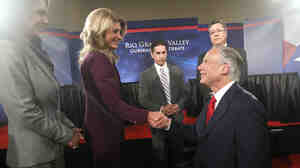 Texas state Sen. Wendy Davis shakes hands with state Attorney General Greg Abbott after their debate in the Rio Grande Valley on Friday.