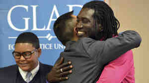 Ugandan gay-rights activist John Abdallah Wambere, right, embraces attorney Janson Wu, after announcing his application for asylum in May. The U.S. government has now formally recommended Wambere's application for approval.
