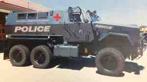 The San Diego School District is sending back a military vehicle it had planned to use in rescue operations. The district had released renderings of what the MRAP might look like after its tan military color is repainted. This version shows it as a police vehicle.