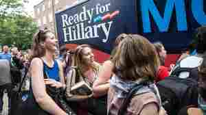 Supporters of Hillary Clinton wait as pro-Clinton volunteers hand out posters and bumper stickers at George Washington University in Washington on June 13.