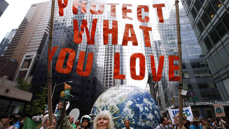 Demonstrators make their way down Sixth Avenue in New York during the People's Climate March on Sunday.