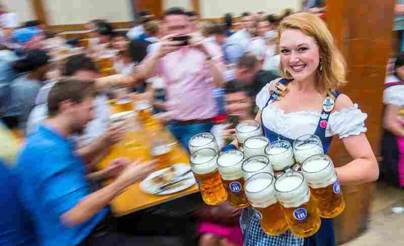 A woman carries 11 liters of beer in the Hofbräu tent.