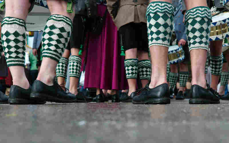 Participants of the Parade of Costumes and Riflemen (Trachten- und Schuetzenzug) wearing 'Wadlstruempfe' traditional Bavarian stockings gather on the second day of the 2014 Oktoberfest in Munich.