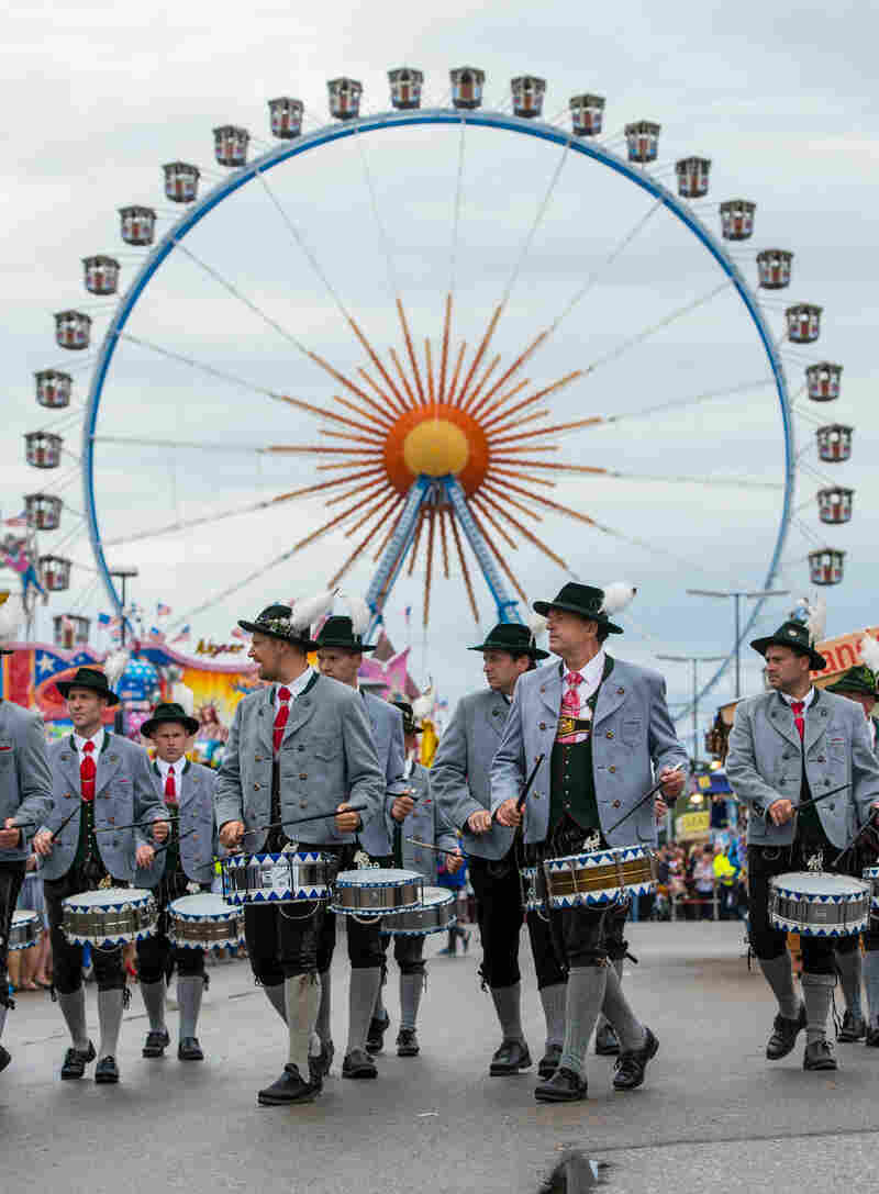 A marching band participates in the costume and shooting club parade at the Oktoberfest in Munich, celebrating Bavaria in Germany.