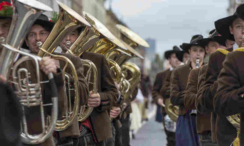 A brass band dressed in traditional Bavarian clothes takes part in the Oktoberfest parade in Munich Sunday.
