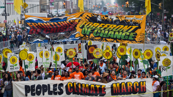 Demonstrators gather near Columbus Circle before the start of the People's Climate March in New York Sunday. Organizers are hoping 100,000 people worldwide might participate in the rally.