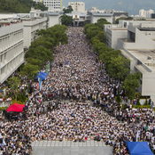 Students and teachers attend a rally during the class boycott at the Chinese University of Hong Kong on Monday. Thousands of students have braved sweltering heat to demand greater democracy for the territory.