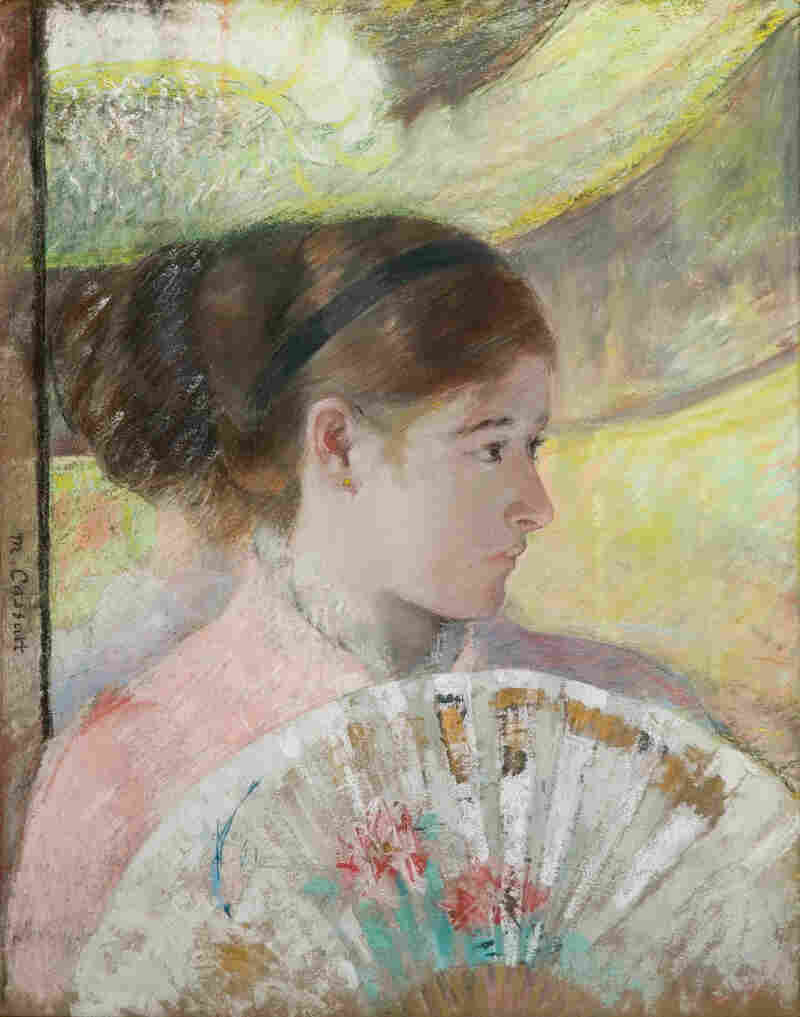 In her 1878-1879 work, At the Theater, Cassatt incorporates metallic paint with gouache and pastel.