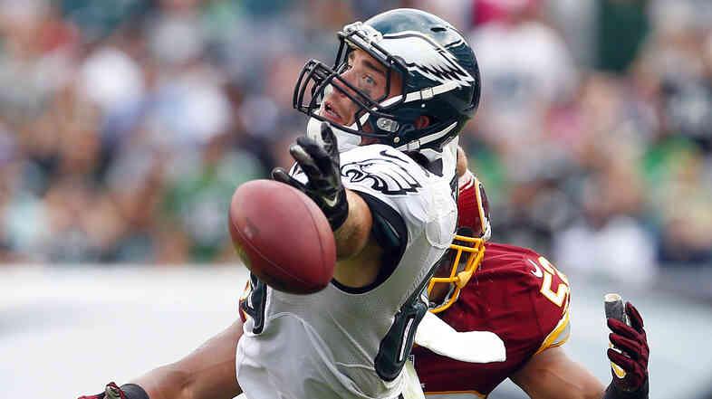 Philadelphia Eagles player Zach Ertz attempts to catch a pass during Sunday's game against the Washington Redskins. Congress has seized on recent controversies to attack the NFL's tax-exempt status.