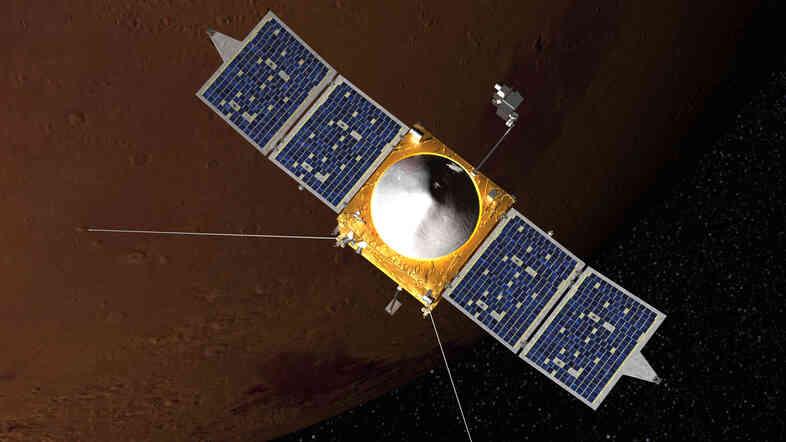 Artist concept of MAVEN spacecraft in orbit around Mars.