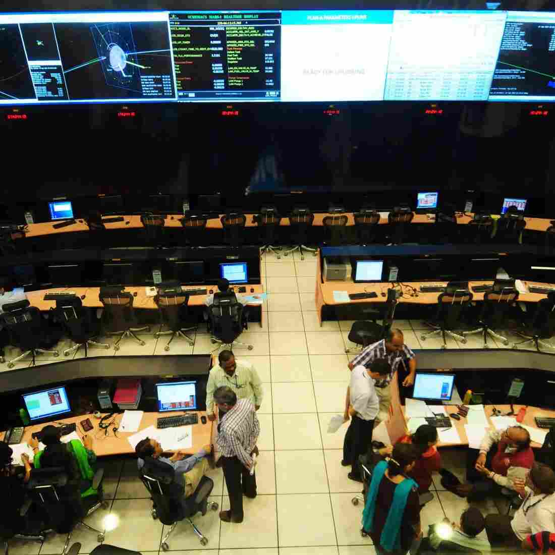 Scientists and engineers at the Indian Space Research Organization (ISRO) monitor the Mars Orbiter Mission (MOM) in Bangalore, India on Sept. 15. MOM is expected to enter into Mars orbit on Wednesday.
