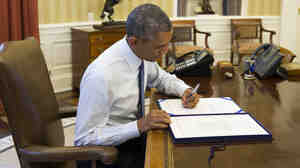 President Obama signs H.J. Res 124, which includes appropriations to train and arm moderate Syrian rebels. For now, the effort will be paid for from an account meant to wind down the war in Afghanistan.