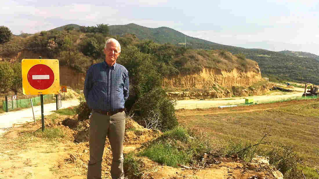 """Athanasios Zournatzis heads the village of Mesolakkia near the tomb. Though the public has not been allowed to visit the tomb itself, he says he's seen a steady stream of international visitors since the discovery was announced. """"We were just a sleepy village of tobacco and almond farmers,"""" he says. """"Now, suddenly we're a tourist attraction."""""""