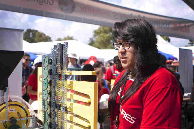 Jessica Yanez, 17, shows off a Rube Goldberg machine built by middle school participants in an after-school maker program called CPEP.