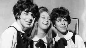 Three members of the singing group the Shangri-Las on a visit to London. Extreme left and right sisters Margie and Mary Anne Ganser, and in the center, Mary Weiss.