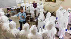 A World Health Organization worker trains nurses how to use Ebola protective gear in Freetown, Sierra Leone.