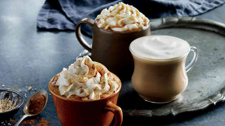 In some parts of the U.S., Starbucks is testing a latte flavored with roasted-stout notes along with its seasonal autumn drinks such as the Pumpkin Spice Latte, seen here at front.