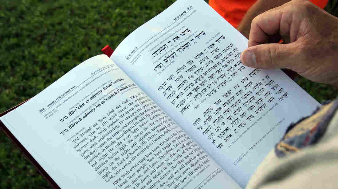 A woman reads a prayer book during Rosh Hashanah last year.