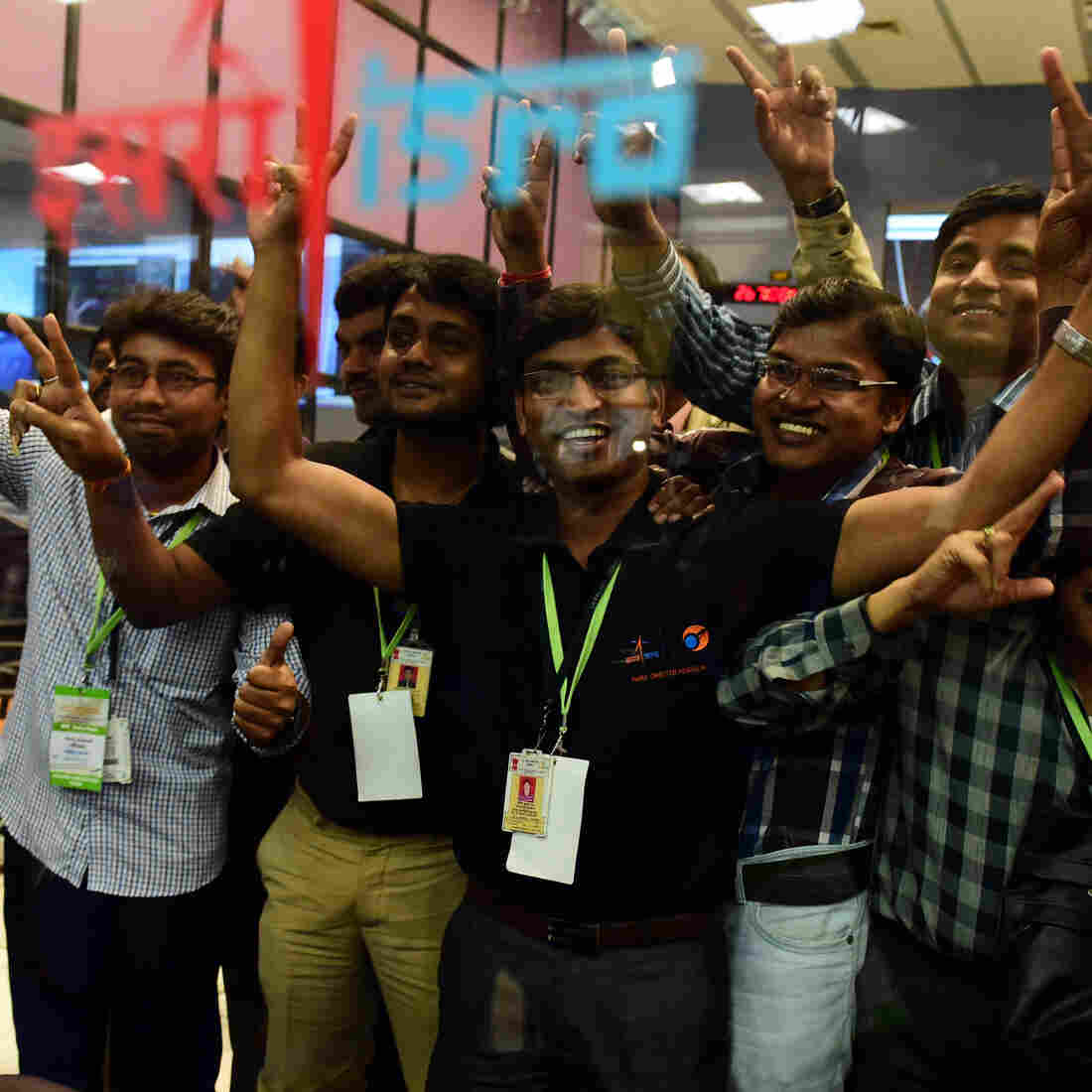 Scientists and officials of Indian Space Research Organization pose for photos as they celebrate the success of Mars Orbiter Mission (MoM) on Wednesday.
