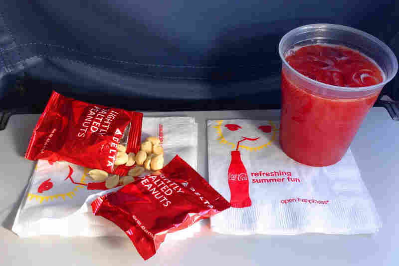 Hungry? These peanuts and drink, served aboard a Delta flight in July, are about all you'll get on domestic flights these days.