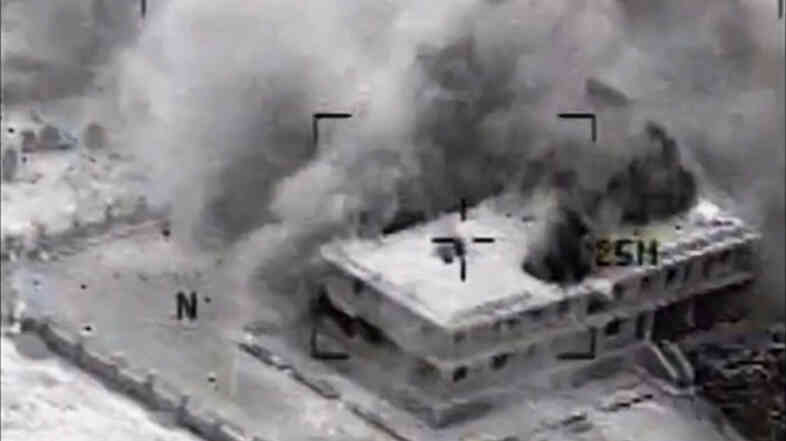 This still image was made from video released by the U.S. military on Tuesday that shows a building hit by a U.S. airstrike in Tall Al Qitar, Syria. The U.S. is describing the bombing campaign in Syria and Iraq as a counterterrorism operation and not a war.