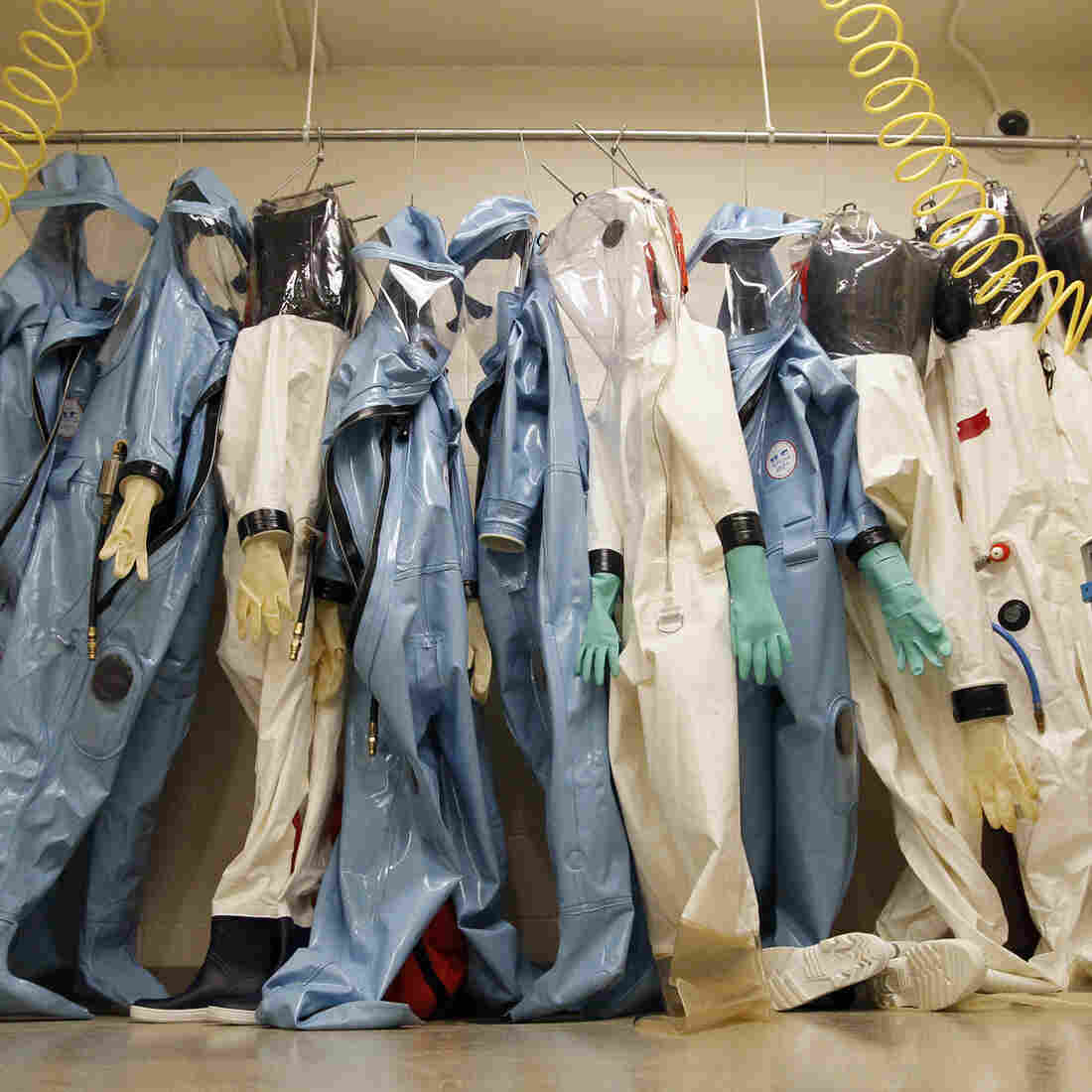 Biohazard suits used to handle dangerous microbes hang in a laboratory at the U.S. Army Medical Research Institute of Infectious Diseases in Fort Detrick, Md.