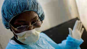 Liberian physician Martha Zarway continues work in a temporary clinic while her original facility is disinfected.
