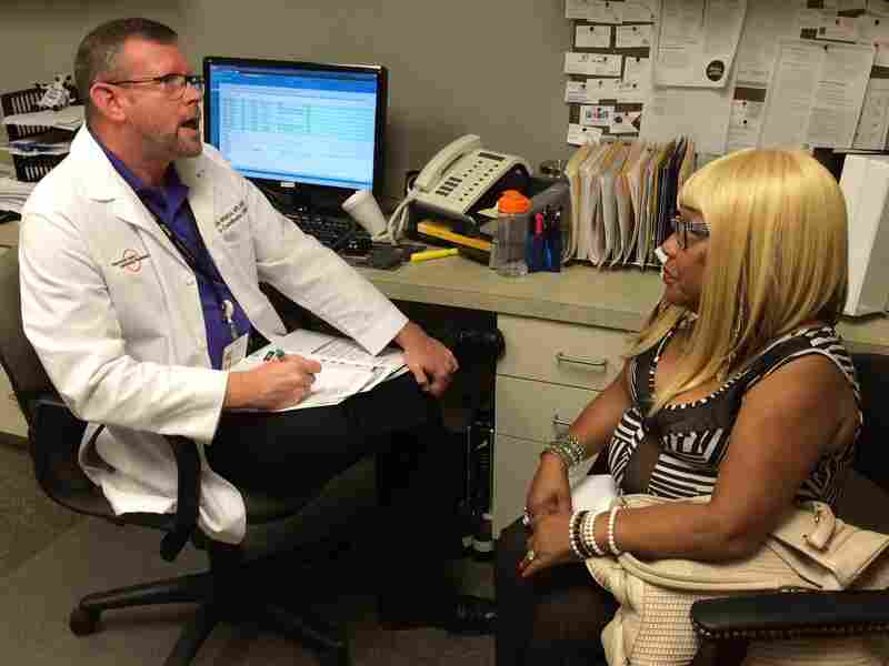 Kevin Wierhs and Susan Johnson confer about what works and what doesn't in managing diabetes.