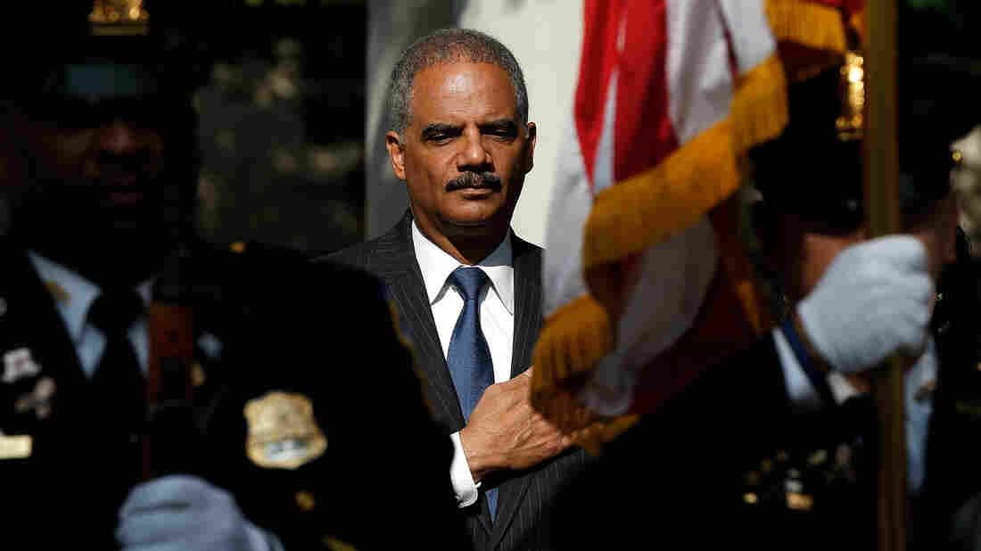 U.S. Attorney General Eric Holder attends a memorial service at the National Law Enforcement Memorial in Washington on the 13th anniversary of the Sept. 11th, 2001, attacks.