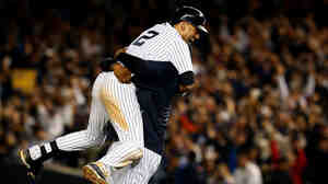 Jeter celebrates after his game-winning RBI in the ninth inning in his last game at Yankee Stadium. The Yankees beat the Orioles 6-5.