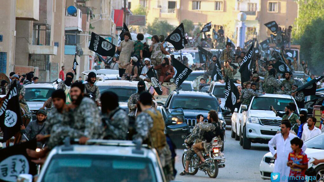 Fighters from the Islamic State group parade in their northern Syrian stronghold, Raqqa.