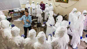 Nurses learn how to use Ebola protective gear in Sierra Leone