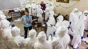 Nurses learn how to use Ebola protective gear in Sierra Leone