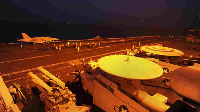 An A-18C Hornet attached to Strike Fighter Squadron (VFA) 87, prepares to launch from the flight deck of the aircraft carrier USS George H.W. Bush (CVN 77) to conduct strike missions against Islamic State group targets.