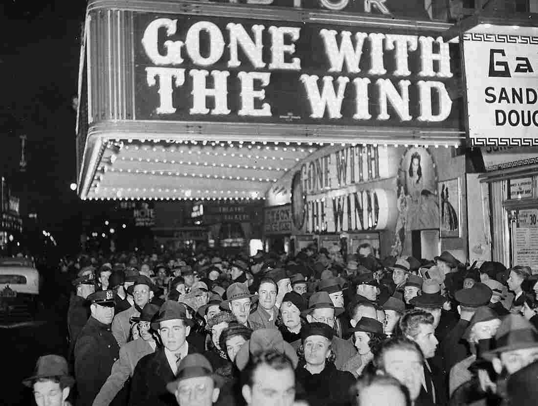 A crowd gathers outside the Astor Theater on Broadway during New York City's Gone with the Wind premiere in December 1939.