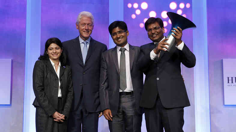 Bill Clinton presented the million-dollar Hult Prize to a team of business school graduates from India.