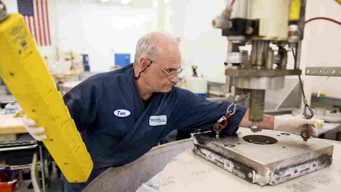Tom Worden works on a fixed-abrasive grinding table at Exelis Inc. in Rochester, N.Y. Exelis is an aerospace and defense company, and employs numerous former Kodak workers in its facility.