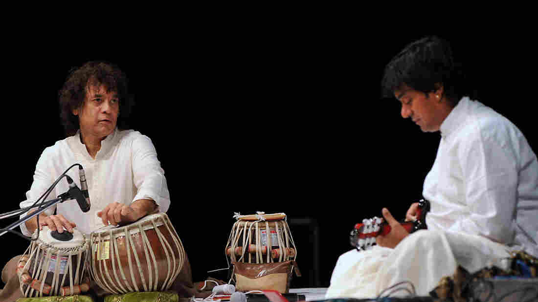 Indian tabla maestro Zakir Hussain and the late mandolin virtuoso U. Srinivas perform together in Mumbai in 2013. U. Srinivas died Sept. 19 at age 45.