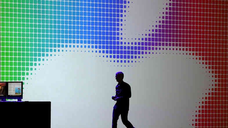 Apple CEO Tim Cook walks off stage after speaking during the Apple Worldwide Developers Conference in June.