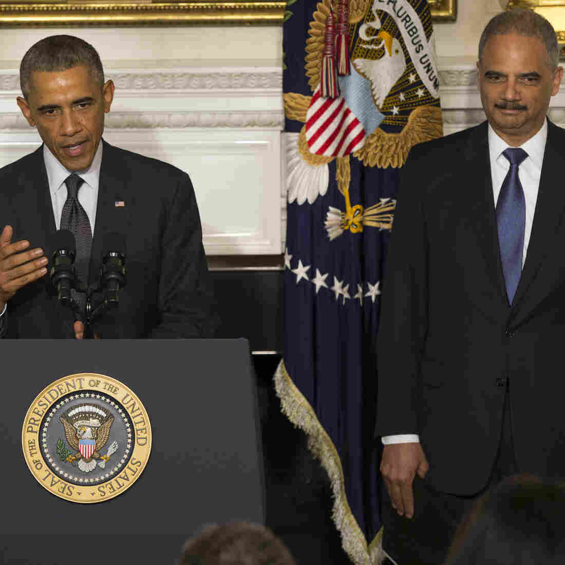 President Obama, accompanied by Attorney General Eric Holder, speaks in the State Dining Room of the White House on Thursday to announce that Holder is resigning. Holder, who served as the public face of the Obama administration's legal fight against terrorism and weighed in on issues of racial fairness, is resigning after six years on the job.