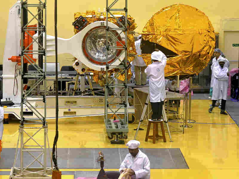 Scientists and engineers work in 2013 on a Mars Orbiter vehicle at the Indian space organization's satellite center, in Bangalore.
