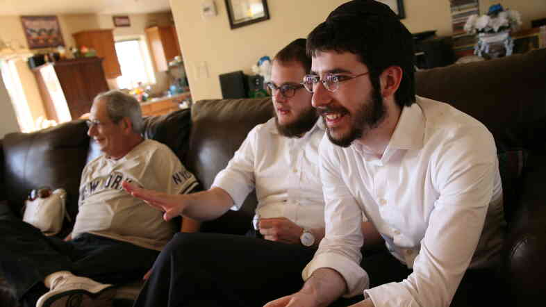 Chabad rabbinical students Zalman Refson (right) and Yaakov Kaplan sit alongside a Jewish resident of Taylor, Ariz. As roving rabbis, the duo recently went to about 40