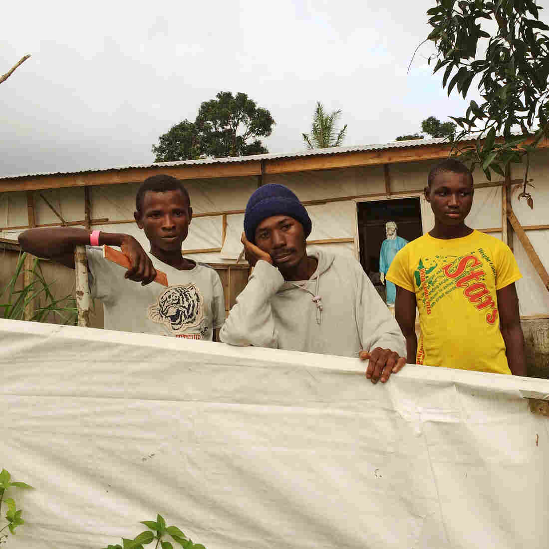 Patients recovering from Ebola at the Kenema treatment center must remain behind white plastic fencing until they are officially discharged.