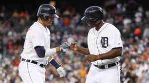 Detroit Tigers Victor Martinez (left) and Torii Hunter celebrate Martinez's two-run home run against the Minnesota Twins on Thursday.