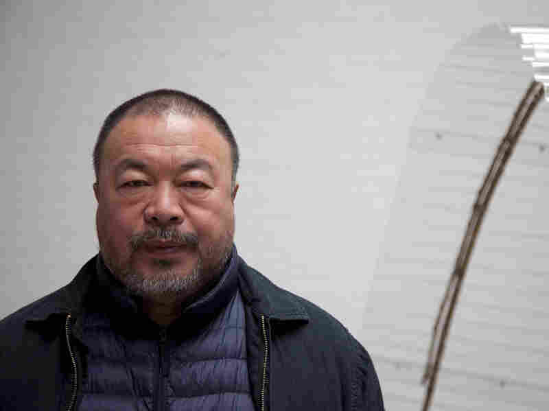 Ai Weiwei stands in his studio in Beijing. The Chinese government has forbidden the dissident artist from leaving China.