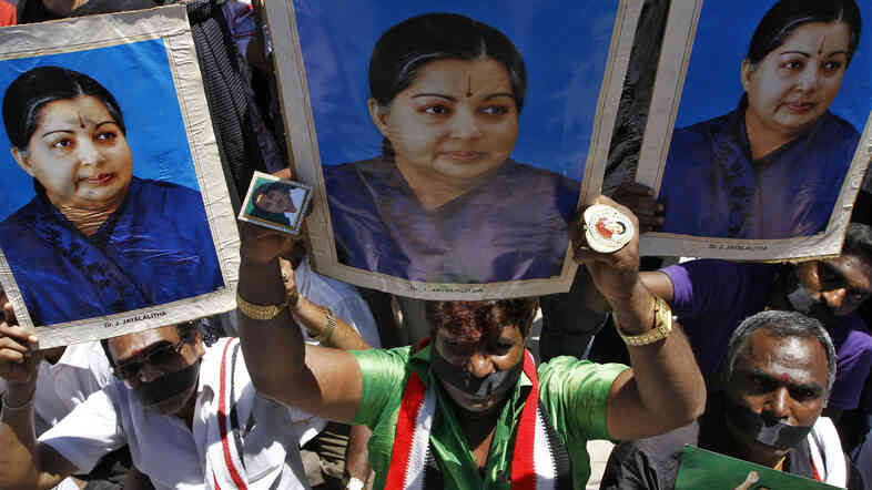 Supporters of J. Jayalalithaa, chief minister of India's Tamil Nadu state and head of the AIADMK party, hold a protest against a prison sentence for the popular politician